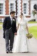 Bride and Groom outside stately home