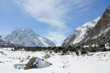 Winter in mountains with blue sky and clouds