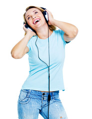 Happy dancing woman with headphones