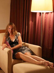 Sexual woman on a chair