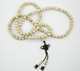 The Tibetan Buddhist mala, beaded rosary, aids counting mantras.