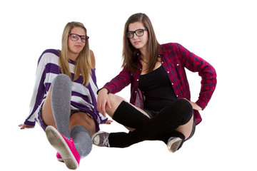 Young trendy teenagers in a nerd / geek style.