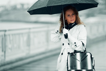 Woman with umbrella.