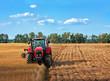 Leinwandbild Motiv Tractors working on field