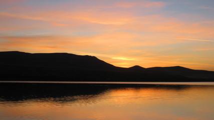 sunrise on morning lake with mountains
