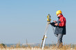 surveyor theodolite worker - 26529458