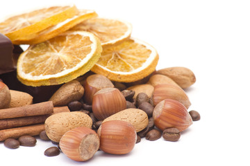 mixed nuts, cinnamon, coffee beans and oranges