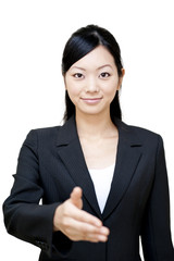portrait of japanese business woman shaking hands
