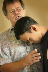 Man Praying With Teenager