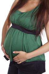 Pregnant body in green