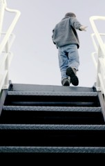 Person Walking Up Stairs