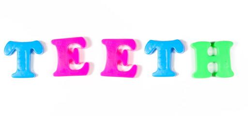 teeth written in fridge magnets