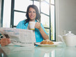 woman having breakfast at home