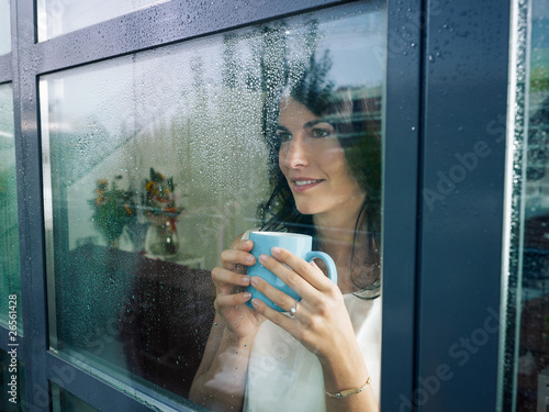 woman staring at the window