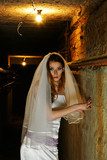 Frightened bride in dungeon