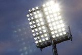 Stadium lights and dark blue sky