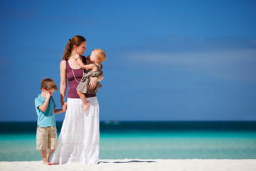 Mother with her two kids on tropical vacation
