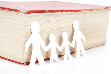 Paper men with book on white background