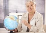 Senior teacher teaching geography poster