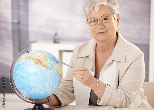 Senior teacher teaching geography
