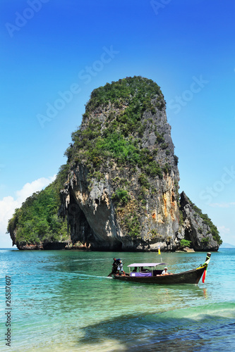Seascape whith exotic island and long tail boat in Thailand