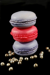 pink and violet macaroons piled