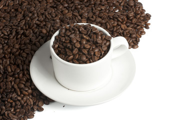 white coffee mug on beans