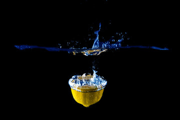 Lemon splash on black background