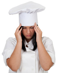 female cook in white uniform and hat suffering from pain