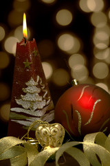 Christmas  still life - red burning candle with evening ball