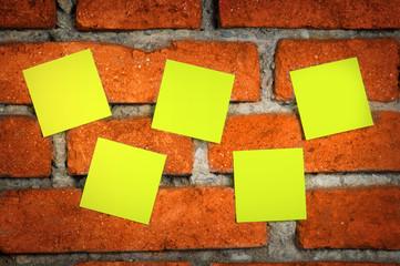 Sticky notes on a brick wall