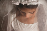 Girl in Holy Communion Dress with a veil