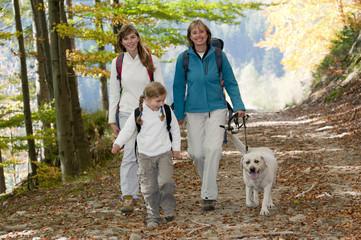 Family with dog on autumn trek