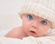 Cute Baby Looking with White Hat - 26607410