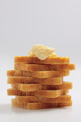Tower from toast bread slices with butter