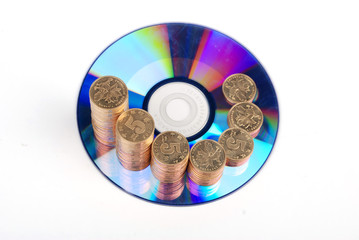 Golden coins with DVD on white background