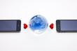 携帯電話と地球とハート