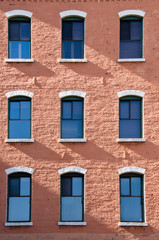 Old fashion windows and red brick wall