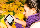 girl reading poetry of Henry Thoreau in autumn park poster