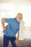 Senior man in sportswear having pain in back poster