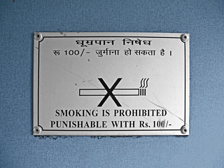 Notice, showing no smocking, wording in English, Hindi languages