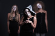 three halloween personages over dark background