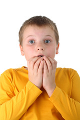 Worried boy with his fingers in mouth isolated on white