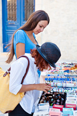 Two woman are choosing jewellery