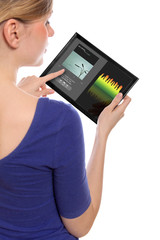 woman holding a touchpad pc, using the music programme