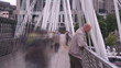 Time lapse of a crowd walking on a bridge