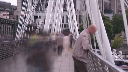 Time lapse of a crowd walking on a bridge