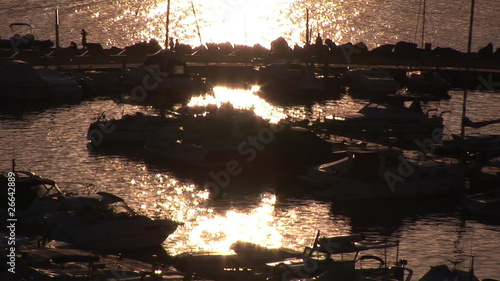 View of a marina full of boats during sunset