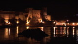 Castle lighten up at night with lake on foreground