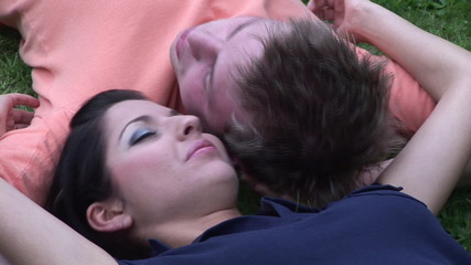 Close up of a lovely couple lying on the grass